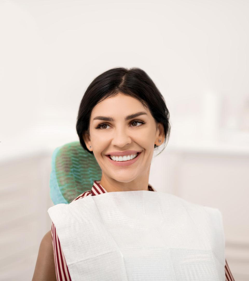 beautiful women smiling in dental chair