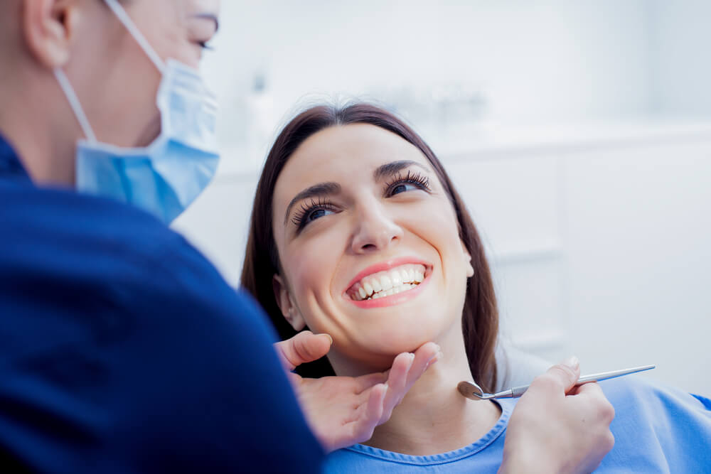 patient feeling happy with her dental treatment